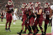 Gabe Marks #9 of the Washington State Cougars celebrates his touchdown against the Stanford Cardinal in the second half with teammates Gerard Wicks #23, John Thompson #85, Eduardo Middleton #73 and Gunnar Eklund #63 at Martin Stadium on October 31, 2015 in Pullman, Washington.  Stanford defeated Washington State 30-28.