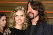 Jordyn Blum (L) and recording artist David Grohl attends the 2014 Vanity Fair Oscar Party hosted by Graydon Carter on March 2, 2014 in West Hollywood, California.