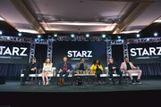 (L-R) Neil Gaiman, Emily Browning, Pablo Schreiber, Orlando Jones, Yetide Badaki, Ian McShane and Ricky Whittle of 'American Gods' speak onstage during Starz 2019 Winter TCA Panel & All-Star After Party on February 12, 2019 in Los Angeles, California.