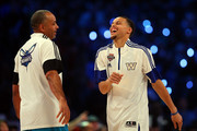 Stephen Curry (R) #30 of the Golden State Warriors and of the Western Conference jokes with his father and NBA Legend Dell Curry during the Degree Shooting Stars Competition as part of the 2015 NBA Allstar Weekend at Barclays Center on February 14, 2015 in the Brooklyn borough of New York City. NOTE TO USER: User expressly acknowledges and agrees that, by downloading and or using this photograph, User is consenting to the terms and conditions of the Getty Images License Agreement.