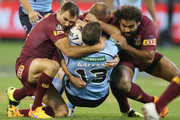 Paul Gallen of the Blues is tackled by Cameron Smith (L) and Sam Thaiday of the Maroons of the Maroons during game two of the State of Origin series between the New South Wales Blues and the Queensland Maroons at the Melbourne Cricket Ground on June 17, 2015 in Melbourne, Australia.