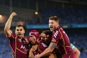 Johnathan Thurston (C) of the Maroons celebrates with Greg Inglis (L) and Chris McQueen (R) after scoring the first try during game three of the ARL State of Origin series between the New South Wales Blues and the Queensland Maroons at ANZ Stadium on July 17, 2013 in Sydney, Australia.