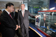 Chinese President Xi Jinping views models of satellites with Rupert Pearce, CEO of Inmarsat (R) during a visit to Inmarsat on October 22, 2015 in London, England. The President of the Peoples Republic of China, Mr Xi Jinping and his wife, Madame Peng Liyuan, end a State Visit to the United Kingdom as guests of The Queen.  They stayed at Buckingham Palace and undertook engagements in London and Manchester. The last state visit paid by a Chinese President to the UK was Hu Jintao in 2005.