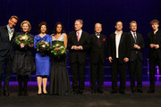 """A groupphoto of all winners (L-R) with Wolfgang Joop, Christiane Hoerbiger, Queen Silvia of Sweden, Christine Neubauer, Horst Koehler, Max Schautzer (Moderator), Steven Sloane, Peter Kloeppel and Tim Bendzko at the """"Steiger Awards"""" at Jahrhundert Halle on March 17, 2012 in Bochum, Germany."""