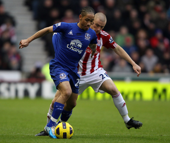 Steven Pienaar Andy Wilkinson of Stoke is challenged by Steven Pienaar of Everton during the Barclays Premier League match between Stoke City and Everton at the Britannia Stadium on January 1, 2011 in Stoke on Trent, England.