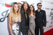 (L-R) Aimee Preston, Steven Tyler, Chelsea Tyler, and Jon Foster at Steven Tyler and Live Nation presents Inaugural Janie's Fund Gala & GRAMMY Viewing Party at Red Studios on January 28, 2018 in Los Angeles, California.