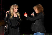 Singer/songwriter Stevie Nicks (L) is joined onstage by recording artist Chrissie Hynde of The Pretenders during the grand opening of Park Theater at Monte Carlo Resort and Casino on December 17, 2016 in Las Vegas, Nevada.