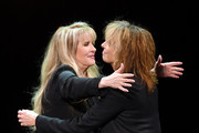 Singer/songwriter Stevie Nicks (L) hugs recording artist Chrissie Hynde of The Pretenders as they perform during the grand opening of Park Theater at Monte Carlo Resort and Casino on December 17, 2016 in Las Vegas, Nevada.