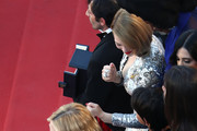 Jury member Cate Blanchett and Léa Seydoux pose with Actor Marcello Fonte with the Best Actor award for his role in 'Dogman' during the closing ceremony of the 71st annual Cannes Film Festival at Palais des Festivals on May 19, 2018 in Cannes, France.