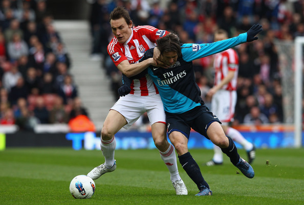 Dean Whitehead of Stoke City holds off Tomas Rosicky of Arsenal during the Barclays Premier League match between Stoke City and Arsenal at Britannia Stadium on April 28, 2012 in Stoke on Trent, England.