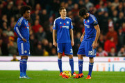 Willian (L) and Diego Costa (R) of Chelsea show their dejection after conceding the first goal to Stoke City during the Barclays Premier League match between Stoke City and Chelsea at Britannia Stadium on November 7, 2015 in Stoke on Trent, England.
