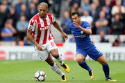 Pedro of Chelsea and Glen Johnson of Stoke City compete for the ball during the Premier League match between Stoke City and Chelsea at Bet365 Stadium on September 23, 2017 in Stoke on Trent, England.