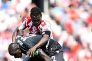 Mame Biram Diouf of Stoke City and Mamadou Sakho of Crystal Palace battle for the ball during the Premier League match between Stoke City and Crystal Palace at Bet365 Stadium on May 5, 2018 in Stoke on Trent, England.