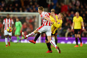 Darren Fletcher of Stoke City tackles Gerard Deulofeu of Watford during the Premier League match between Stoke City and Watford at Bet365 Stadium on January 31, 2018 in Stoke on Trent, England.
