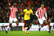 Abdoulaye Doucoure (C) of Watford competes for the ball against Bruno Martins Indi (L) and Glen Johnson (R) of Stoke City during the Premier League match between Stoke City and Watford at Bet365 Stadium on January 3, 2017 in Stoke on Trent, England.