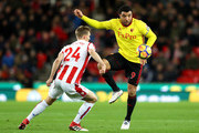 Troy Deeney of Watford is challenged by Darren Fletcher of Stoke City during the Premier League match between Stoke City and Watford at Bet365 Stadium on January 31, 2018 in Stoke on Trent, England.