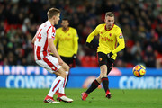 Gerard Deulofeu of Watford passes the ball under pressure from Darren Fletcher of Stoke City  during the Premier League match between Stoke City and Watford at Bet365 Stadium on January 31, 2018 in Stoke on Trent, England.
