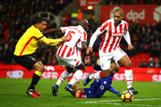 Glen Johnson (1st R) of Stoke City runs with the ball during the Premier League match between Stoke City and Watford at Bet365 Stadium on January 3, 2017 in Stoke on Trent, England.