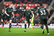 David Silva of Manchester City (21) celebrates as he scores their second goal with Kevin De Bruyne and Gabriel Jesus during the Premier League match between Stoke City and Manchester City at Bet365 Stadium on March 12, 2018 in Stoke on Trent, England.