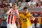 Ryan Giles of Wolverhampton Wanderers breaks away from Darren Fletcher during the pre-season friendly match between Stoke City and Wolverhampton Wanderers at the Bet365 Stadium on July 25, 2018 in Stoke on Trent, England.