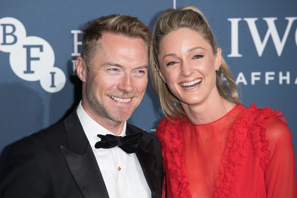 IWC Schaffhausen Gala Dinner In Honour Of The BFI - Arrivals [premiere,event,carpet,smile,suit,style,storm keating,ronan keating,l-r,england,london,electric light station,iwc schaffhausen gala dinner in honour of the bfi - arrivals,bfi iwc schaffhausen gala dinner]
