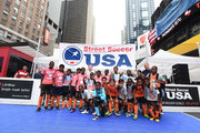 American soccer player Dax McCarty poses with a team during the Street Soccer USA Cup at Times Square on July 9, 2016 in New York City.