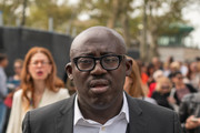 Edward Enninful, Editor and Chief of British Vogue, is seen wearing a black suit and white shirt at the Carolina Herrera show during New York Fashion Week at the Garden of the Battery on September 9, 2019 in New York City.