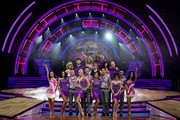 (Front L-R)  Joanne Clifton, Frankie Bridge, Kevin Clifton, Helen George, Aljaz Skorjanec,  Anita Rani, Gleb Savchenko, Georgia May Foote, Giovanni Pernice and Karen Clifton, host Mel Giedroyc (C) and (Back L-R) Aliona Vilani, Jay McGuiness, Natalie Lowe, Ainsley Harriott, Janette Manrara and Jake Wood pose during a photocall for the Strictly Come Dancing Live Tour 2016 at Barclaycard Arena on January 21, 2016 in Birmingham, England.