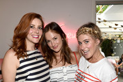 """(L-R) Rebecca Feferman, Head of SXsports, actress Minka Kelly and Ashley Streicher attend a celebration with Striiike and Caudalie for """"The French Beauty Solution"""" on Bastille Day at Striiike on July 14, 2015 in Beverly Hills, California."""