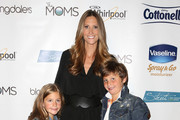 Stephanie Winston Wolkoff and children poses backstage at Strut: The Fashionable Mom Show during Mercedes-Benz Fashion Week Spring 2014 at Lincoln Center for the Performing Arts on September 7, 2013 in New York City.