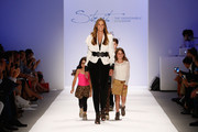 Stephanie Winston Wolkoff walks the runway with models at Strut: The Fashionable Mom Show during Mercedes-Benz Fashion Week Spring 2014 at Lincoln Center for the Performing Arts on September 7, 2013 in New York City.