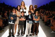 Denise Albert, Stephanie Winston Wolkoff and Melissa Gerstein and models pose on the runway at Strut: The Fashionable Mom Show during Mercedes-Benz Fashion Week Spring 2014 at Lincoln Center for the Performing Arts on September 7, 2013 in New York City.