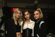 Models Devon Windsor, Gigi Hadid, and Rachel Hilbert attend Stuart Weitzman's Launch Of The Gigi Boot on October 26, 2016 in New York City.