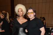 Solange (L) and  Stuart Weitzman Creative Director Giovanni Morelli attend the Stuart Weitzman FW18 Presentation and Cocktail Party at The Pool on February 8, 2018 in New York City.