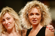 """Valeria Bruni Tedeschi and Valeria Golino walk the red carpet ahead of the """"The Summer House (Les Estivants)"""" screening during the 75th Venice Film Festival at Sala Grande on September 5, 2018 in Venice, Italy."""
