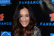 Actress Maggie Q laughs as she arrives at Summit Entertainment's press event for the movies 'Ender's Game' and 'Divergent' at the Hard Rock Hotel San Diego on July 18, 2013 in San Diego, California.