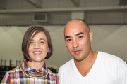 Designers Erin Beatty (L) and Max Osterweis pose backstage at the Suno fashion show during MADE Fashion Week Spring 2014 at Center 548 on September 6, 2013 in New York City.