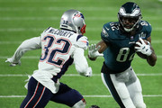 Torrey Smith #82 of the Philadelphia Eagles carries the ball defended by Devin McCourty #32 of the New England Patriots in the third quarter of Super Bowl LII at U.S. Bank Stadium on February 4, 2018 in Minneapolis, Minnesota.