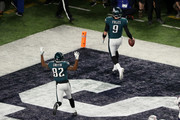 Nick Foles #9 of the Philadelphia Eagles is congratulated by his teammate Torrey Smith #82 after his 1-yard touchdown reception during the second quarter against the New England Patriots in Super Bowl LII at U.S. Bank Stadium on February 4, 2018 in Minneapolis, Minnesota.
