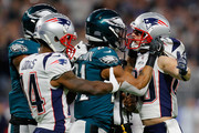 Patrick Robinson #21 of the Philadelphia Eagles and Danny Amendola #80 of the New England Patriots exchange words after the whistle during the second quarter in Super Bowl LII at U.S. Bank Stadium on February 4, 2018 in Minneapolis, Minnesota.