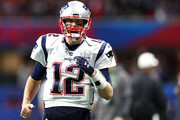 Tom Brady #12 of the New England Patriots runs onto the field before Super Bowl LIII against the Los Angeles Rams at Mercedes-Benz Stadium on February 03, 2019 in Atlanta, Georgia.