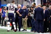 Tom Brady #12 of the New England Patriots and Patriots owner Robert Kraft talk before Super Bowl LIII at Mercedes-Benz Stadium on February 03, 2019 in Atlanta, Georgia.