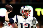 Tom Brady #12 of the New England Patriots makes a pass against the Los Angeles Rams during Super Bowl LIII at Mercedes-Benz Stadium on February 03, 2019 in Atlanta, Georgia.