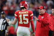 Head coach Andy Reid talks to Patrick Mahomes #15 of the Kansas City Chiefs during the fourth quarter in Super Bowl LIV at Hard Rock Stadium on February 02, 2020 in Miami, Florida.