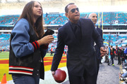 Former baseball player Alex Rodriguez autographs a ball before Super Bowl LIV at Hard Rock Stadium on February 02, 2020 in Miami, Florida.