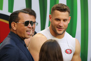 Alex Rodriguez talks to Nick Bosa #97 of the San Francisco 49ers before Super Bowl LIV at Hard Rock Stadium on February 02, 2020 in Miami, Florida.