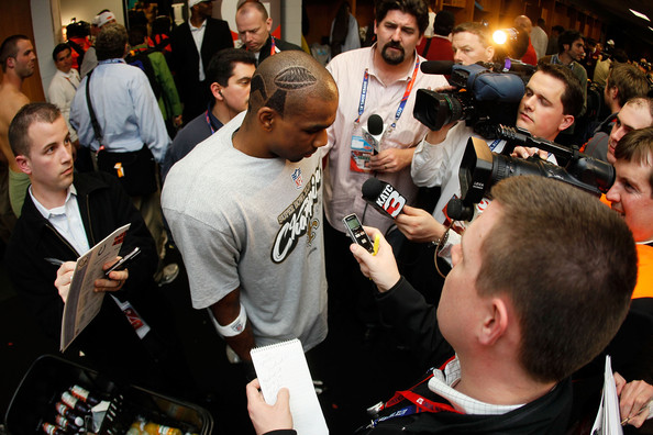 Tracy Porter #22 of the New Orleans Saints speaks in the locker room after defeating the Indianapolis Colts during Super Bowl XLIV on February 7, 2010 at Sun Life Stadium in Miami Gardens, Florida.