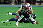 Julian Edelman Tharold Simon Photos Photo
