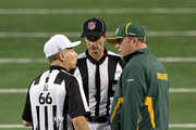 Head coach Mike McCarthy of the Green Bay Packers talks to referee Walt Anderson #66 about a challenged play during Super Bowl XLV against the Pittsburgh Steelers at Cowboys Stadium on February 6, 2011 in Arlington, Texas.