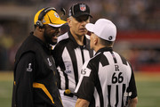 Head coach Mike Tomlin of the Pittsburgh Steelers talks to referee Walt Anderson #66 during the second quarter against the Green Bay Packers in Super Bowl XLV at Cowboys Stadium on February 6, 2011 in Arlington, Texas.